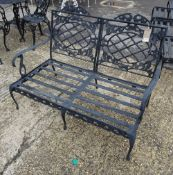 Forecast Furniture LTD; a pair of black painted metal garden benches, 122cm wide x 84cm high, (2).
