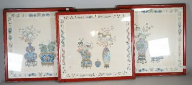 A group of three mid-20th century Chinese painted silk pictures depicting vases of flowers,