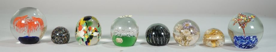 A large quantity of mostly 20th century glass paperweights of various sizes and designs, (34).