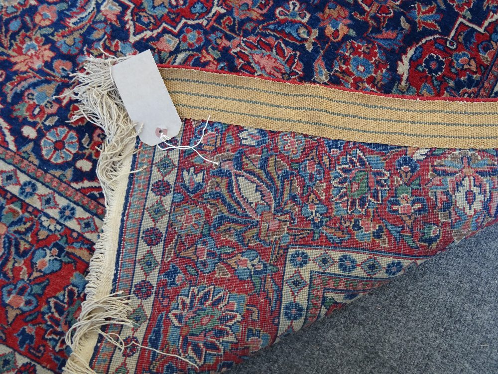 Lot 1536 - A Kashan rug, Persian, the indigo field with a madder medallion, matching spandrels,