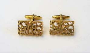 A pair of 9ct gold cufflinks, each with a rectangular front,