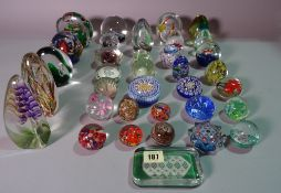 A large quantity of mostly 20th century glass paperweights of various sizes and designs, (36).
