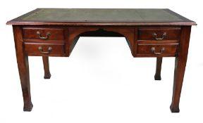 An early 20th century mahogany desk with