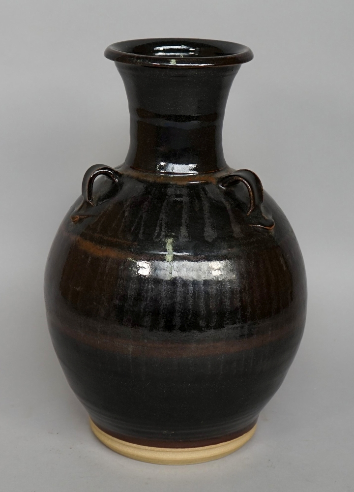 Lot 1500 - A large vase with three handles, decorat