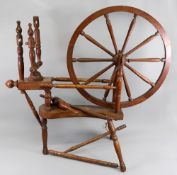 A turned oak, beech and elm spinning whe
