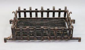 A large rectangular cast iron fire baske