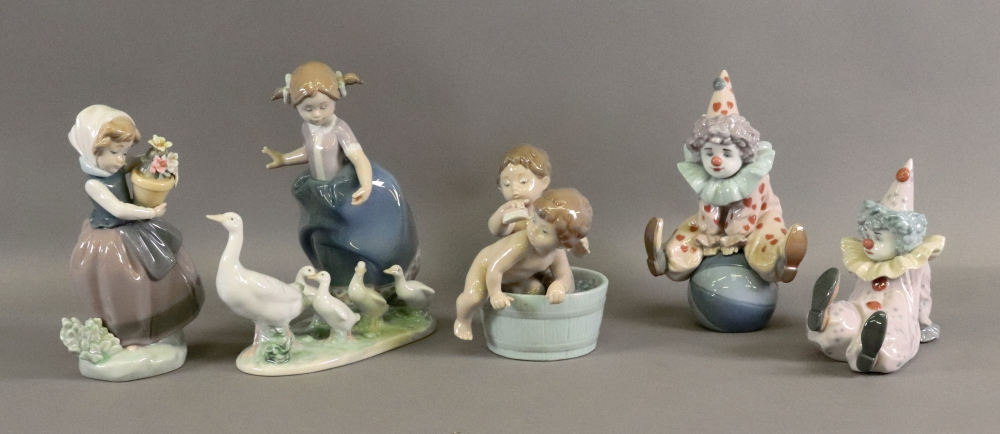 Lot 1354 - A collection of five Lladro figurines, i