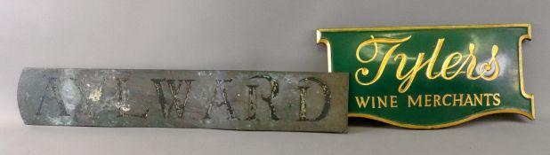 A brass sign stamped Aylward, 66cm wide