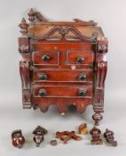 An unusual early Victorian carved mahoga