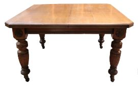 A late Victorian light oak extending dining table,