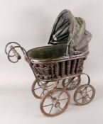 A doll's pram, on four spoked wheels wit