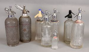 Two vintage glass soda syphons with pier