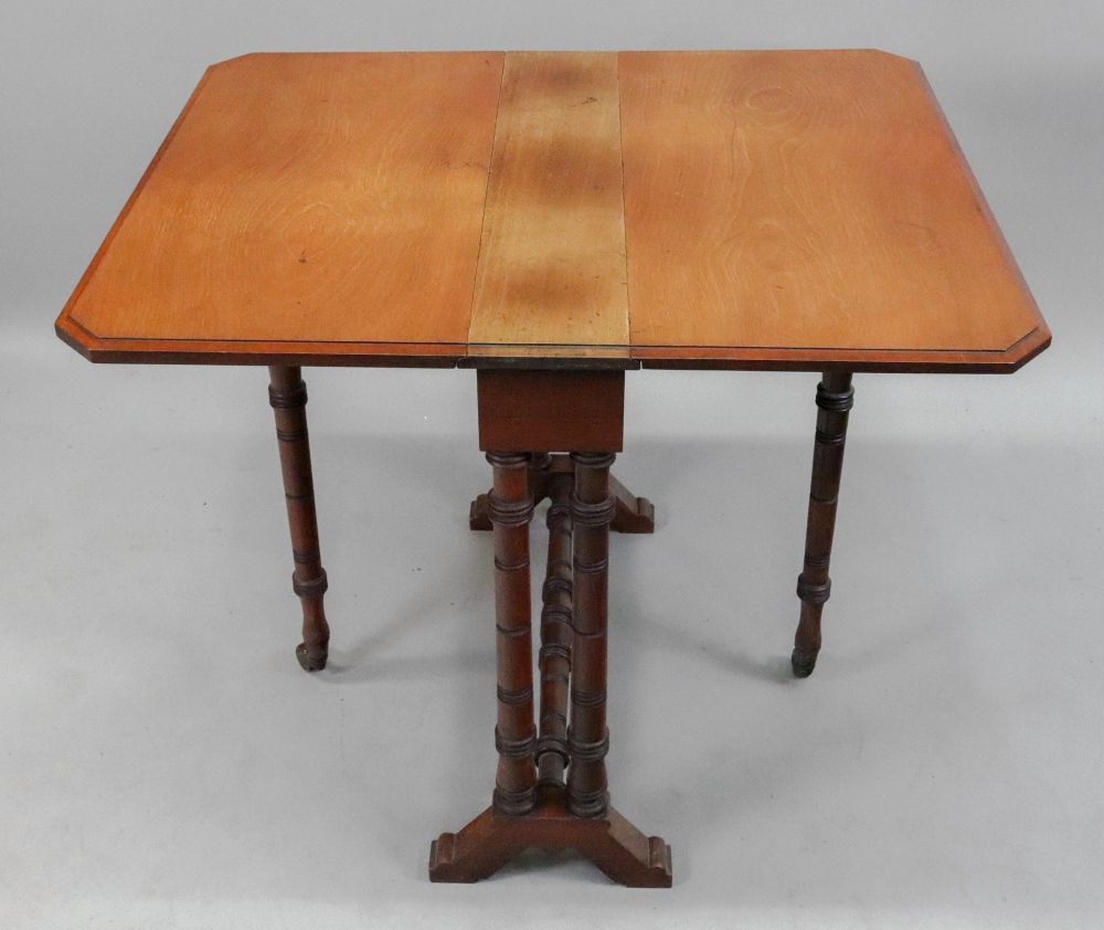 Lot 1530 - An Edwardian walnut sutherland table, on