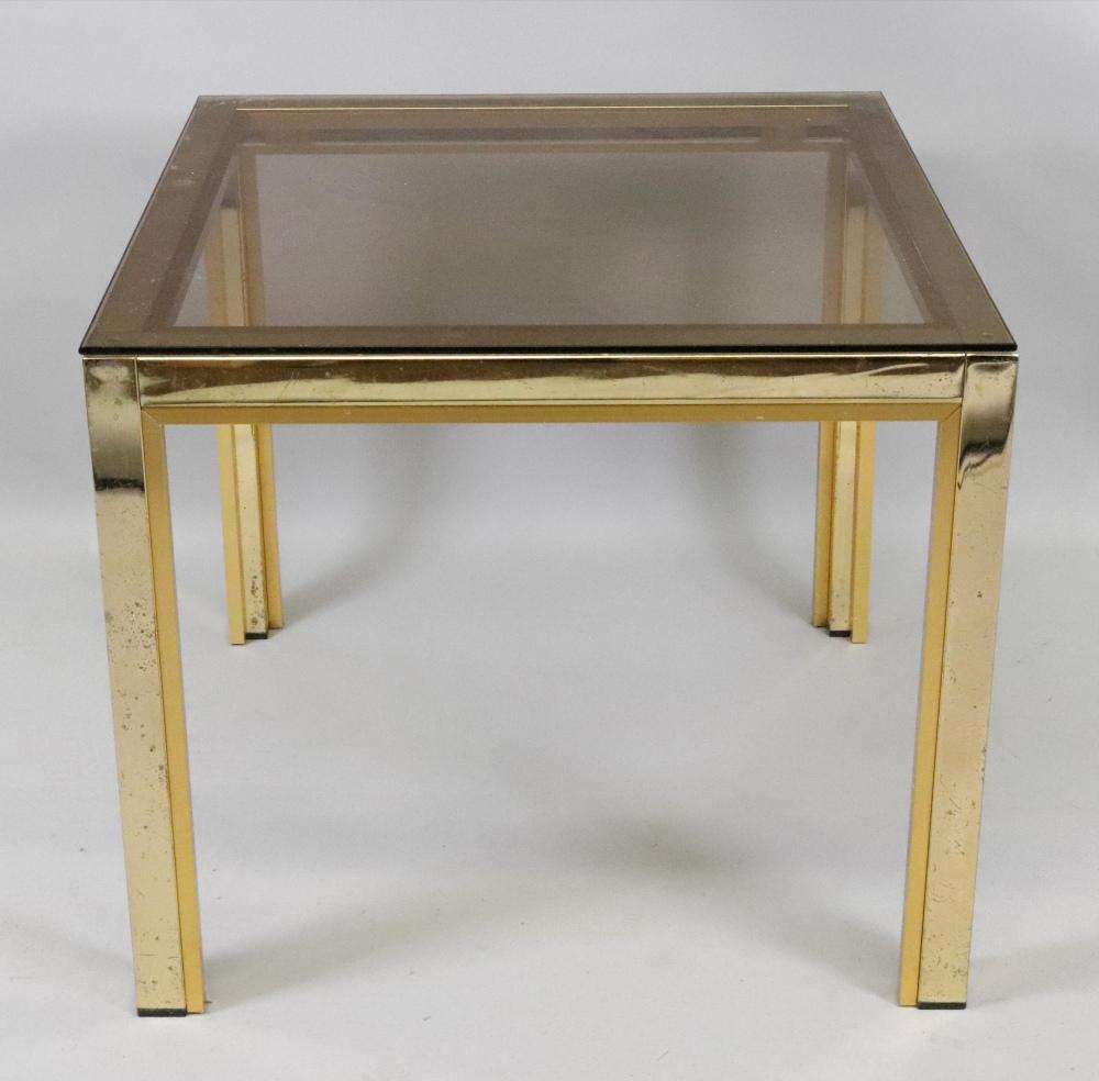 Lot 1375 - A square gilt metal frame low centre tab