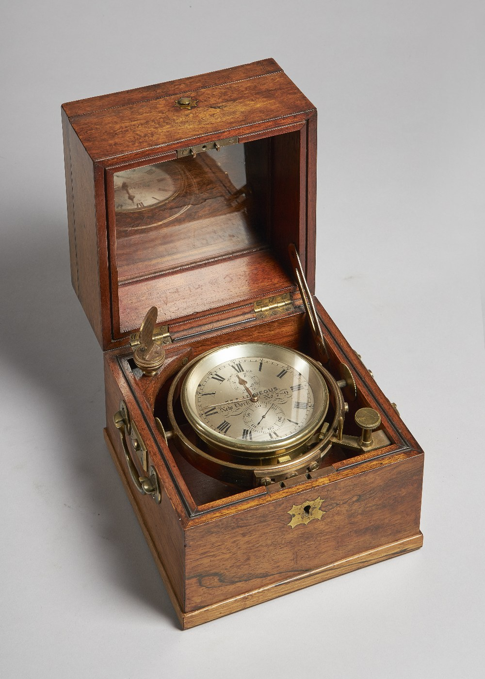 Lot 683 - An interesting American walnut cased two-day marine chronometer By T. S. & J. D.