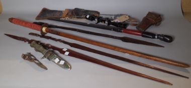 Collectables, including; tribal spears, a wooden training katana,