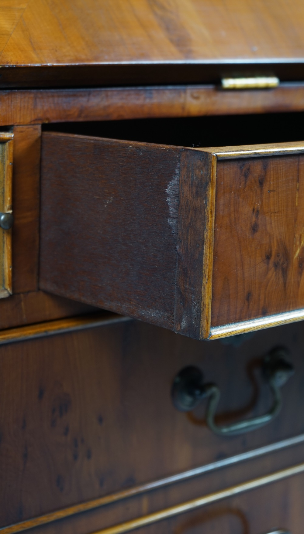Lot 1831 - An early 18th century style yew bureau bookcase,