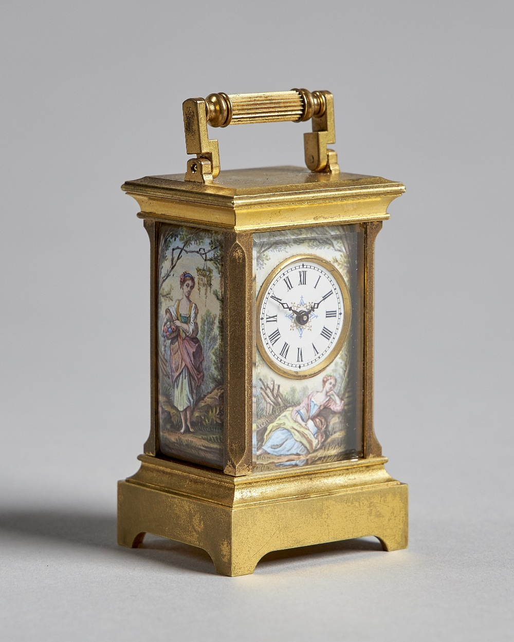 Lot 691 - A Fine and Rare miniature enamelled carriage timepiece Circa 1900 The case with reeded handle