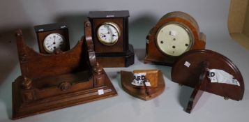 Horological interest, comprising; a group of five 20th century wall mounted clocks and a bracket,