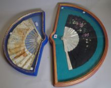 An 18th century framed paper fan, hand painted with classical scenes,