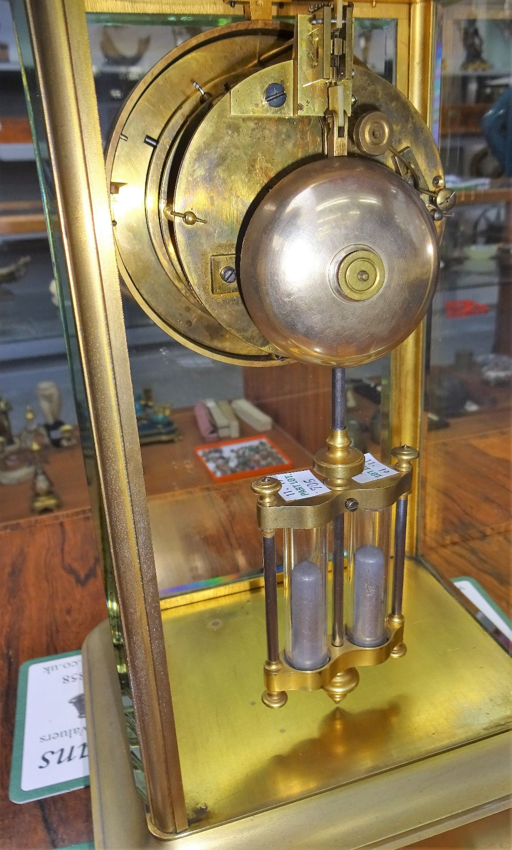Lot 706 - A French giltbrass four-glass mantel clock Circa 1870 With a stepped pediment above bevelled glass