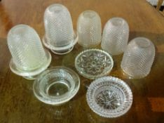A large quantity of modern moulded glass candle and tea light holders, (qty).