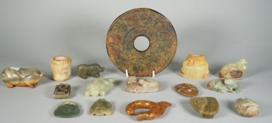 A group of Chinese archaistic jade carvings, of various colour and size,