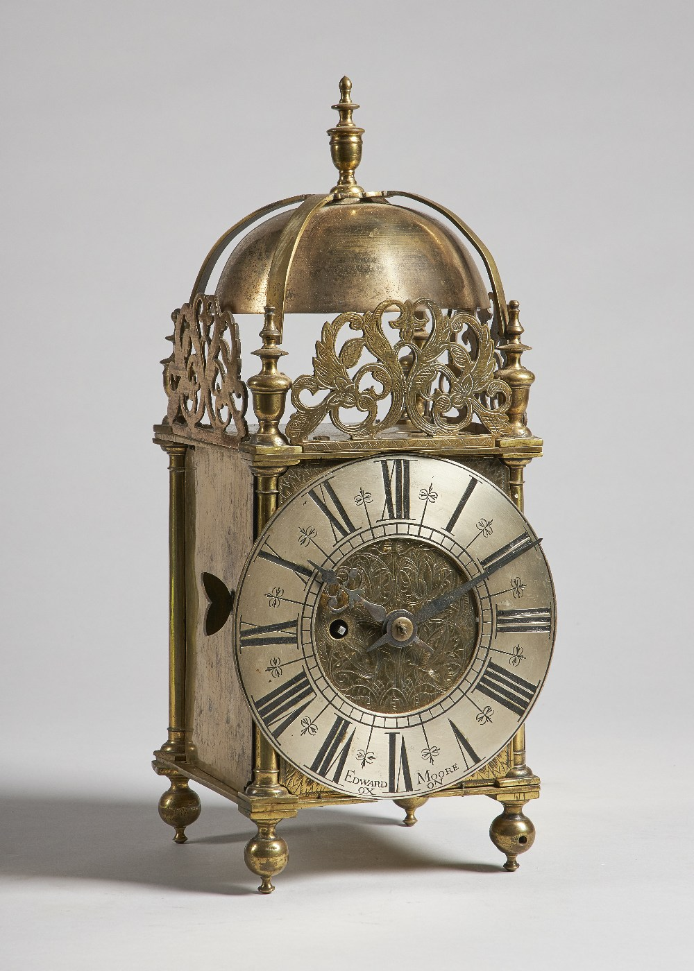 Lot 648 - A brass lantern timepiece The dial signed Edward Moore, Oxon, the frame 18th century,