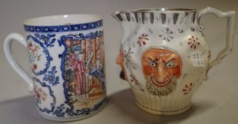 A 19th century Mask jug, 14cm high and a Cantonese export tankard, (a.f.), (2).