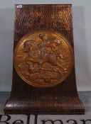 An early 20th century copper stand with circular embossed panel of George and the Dragon,