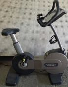 Techno Gym; an upright exercise bike.