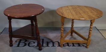 An early 20th century oak cricket table on barley-twist supports,
