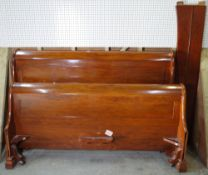 Simon Horn 1996; a 20th century walnut king size sleigh bed, 188cm wide x 125cm high.