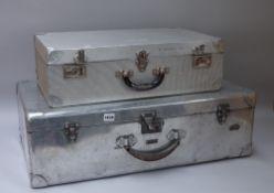 Two aluminium suitcases, the largest 74cm x 44cm x 24cm.