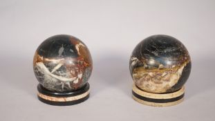 Two 19th century marble spheres, each on a marble dished stand, spheres 10cm diameter, (4).