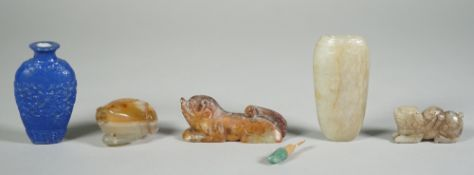 A group of four Chinese jade carvings, comprising; two small recumbent animals, 4cm. and 6cm.