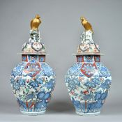 A large pair of Japanese Arita octagonal vases and covers, Edo period, circa 1700,
