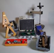 Horological interest; a quantity of watchmaker's tools, mainly clamps, brackets and sundry, (qty).