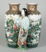 A Japanese ao-kutani double vase, Meiji period, the conjoined vases painted with river landscapes,