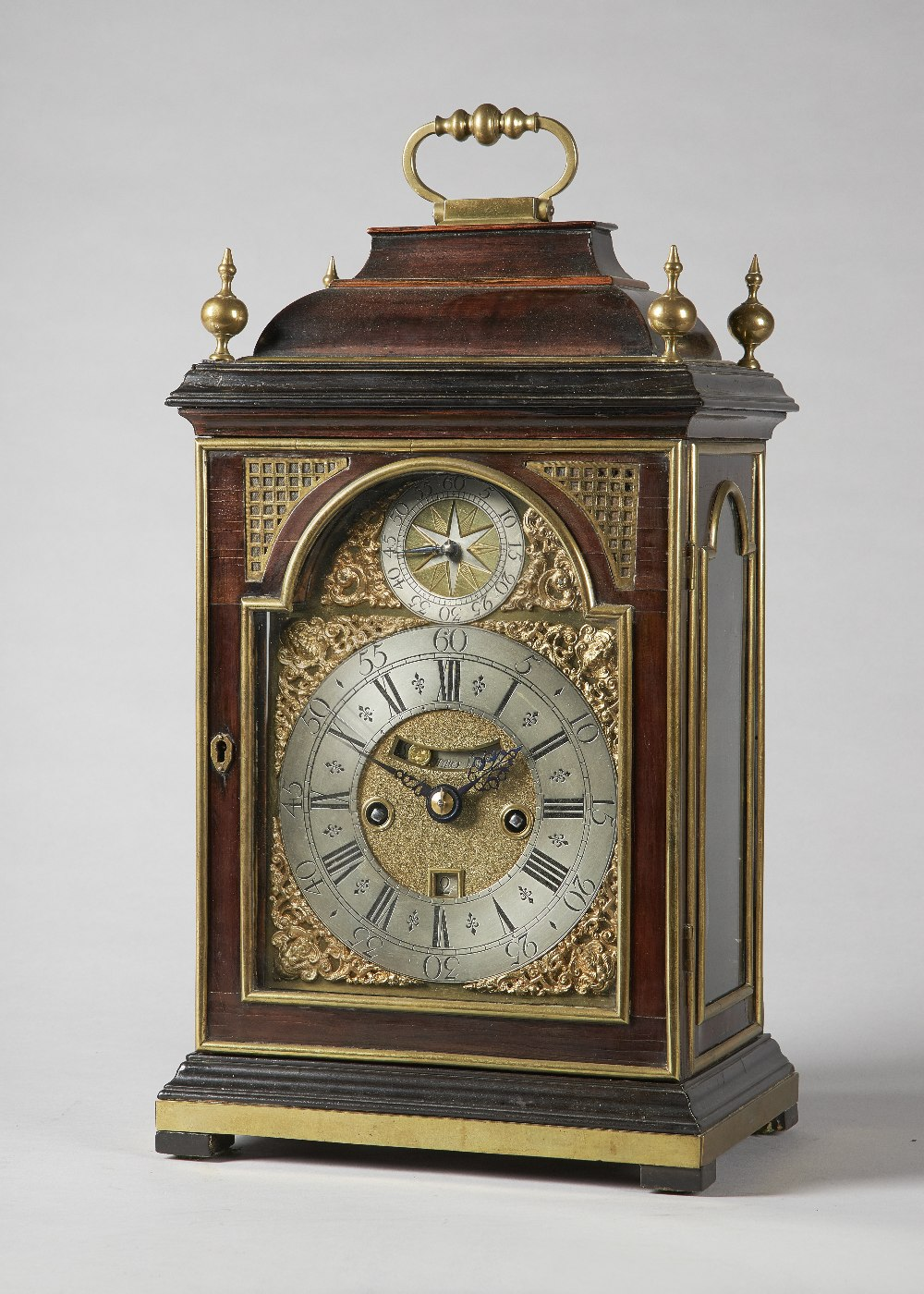 Lot 672 - A George I brass-mounted fruitwood striking table clock with pull-quarter repeat By Simon de