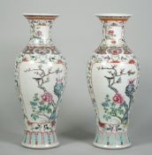 A pair of Chinese famille-rose slender baluster vases, circa 1900,