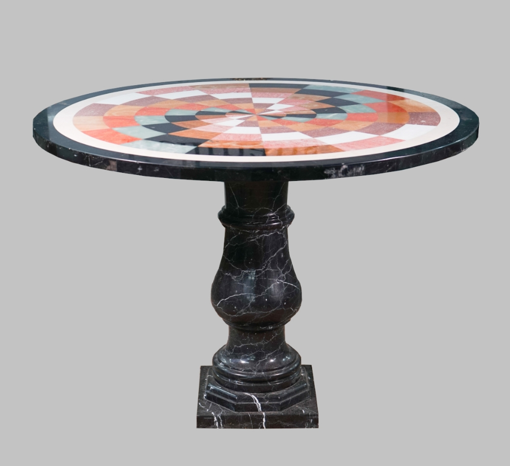 Lot 1869 - A modern marble occasional table, the specimen inlaid circular top on baluster column,