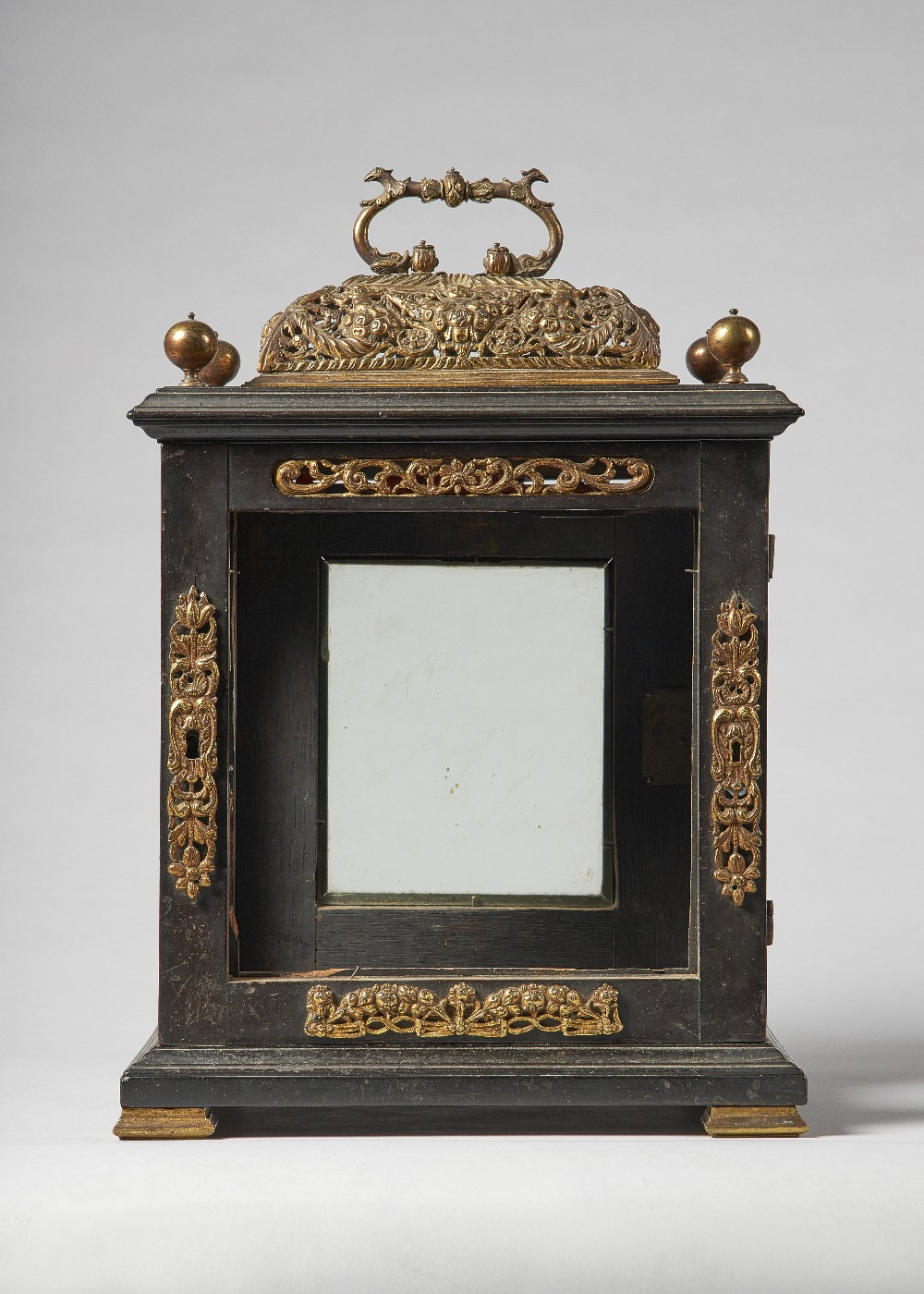 Lot 671 - A giltmetal-mounted ebonised table clock case Late 17th century With pierced basket and four