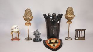A pair of gilt-wood carved pineapple finials on metal stands, 34cm high,