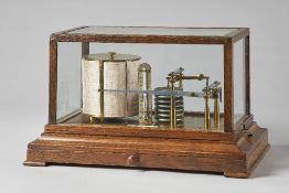 An Edwardian oak cased barograph Signed Turnbull & Co.