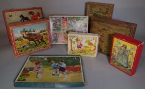 Toys comprising; a quantity of mid-20th century vintage puzzles and building blocks, (qty).