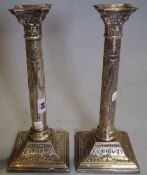 A pair of Regency style silver plated candlesticks, 31cm high (2).