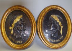 A pair of modern giltwood oval panels,