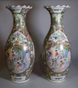 A pair of Chinese Canton style baluster vases, 62cm high.