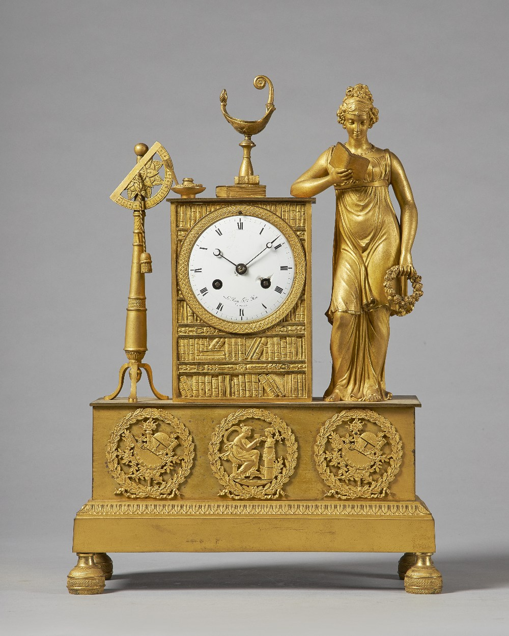 Lot 701 - An Empire ormolu mantel clock Signed Le Roy, Paris Modelled with a standing female figure reading,